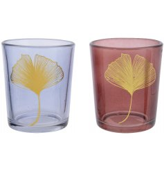 An assortment of 2 glass t-light holders in bluestone and rosewood colours, each with a gold ginko print.