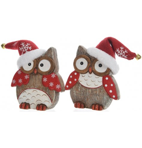 An assortment of 2 ceramic owl decorations with a wood effect finish. Each has a fur trim Santa hat with gold bell.