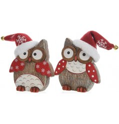 A mix of 2 ceramic owl decorations, each with a wood effect finish. Complete with a red Santa hat with bell.
