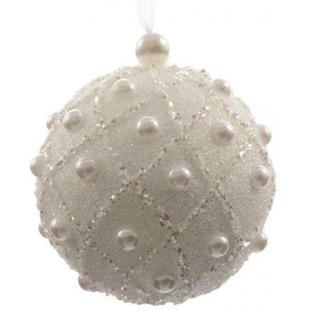 A chic and glamorous foam bauble with glitter and pearls in a vintage decorative pattern.