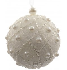 A chic white glitter bauble with pearls. An ornate decoration for you home this season.