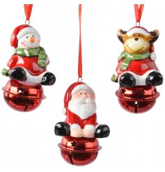 An assortment of 3 bright and fun Reindeer, Santa, and Snowman bell tree ornaments.
