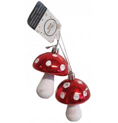 A red and white spotted mushroom decoration with glitter detailing. A shatterproof item for your festive tree