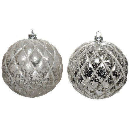 An assortment of 2 silver baubles with an antique surface and pillow quilt finish.