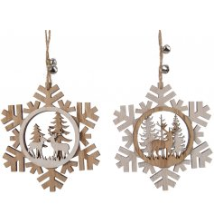 An assortment of 2 wooden snowflake design decorations with woodland stag and reindeer silhouettes.