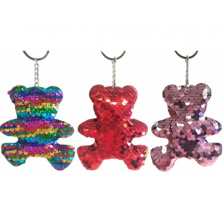 An assortment of funky sequin covered keyrings in a teddy bear form