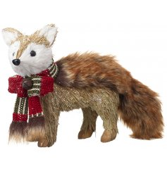 Dressed up in a snuggly knitted scarf, this festive fox decoration is made up of dried grass and faux fur trimmings