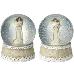 A beautiful mix of resin snow globes featuring angelic centres and falling glitter displays