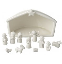 A sweet and simple ceramic nativity scene display made up of an array of characters