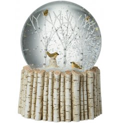 With a birch bases, a woodland bird scene within a snowglobe.
