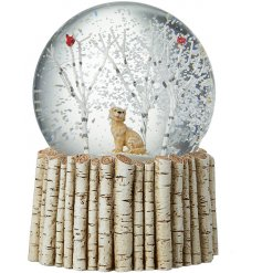 A winter wonderland dog and birds inside a snowglobe with a birch base.