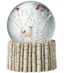 A winter wonderland reindeer and birds inside a snowglobe with a birch base.