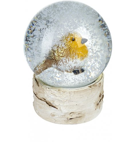 A traditional woodland inspired snow globe with a bark effect base with a traditional Robin ornament inside.