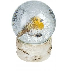 A charming little robin sat in a snowglobe with a woodland base.