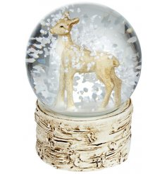 A charming reindeer set in a snowglobe with a woodland base.