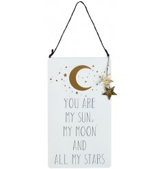 A meaningful quote in white and gold with hanging star detail and gold moon and stars.