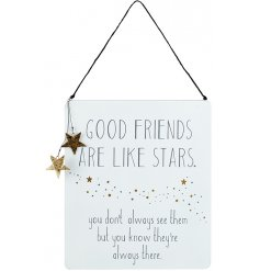 A meaningful friendship quote in white and gold with hanging star detail.