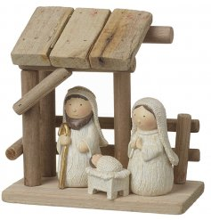 These adorable resin figures create the perfect nativity scene within a wooden shelter.