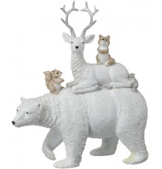 A beautiful standing polar bear ornament with added woodland characters on top