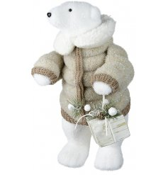 An adorable standing foam polar bear decoration, dressed up in a super snuggly puffer coat