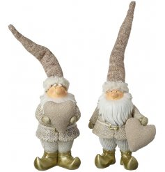 An assortment of neutral toned standing resin santa figures, perfectly set with tall pointed hats and fabric heart decas