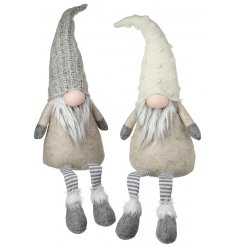 A mix of 2 large fabric gonks in grey and beige tones complete with dangly legs