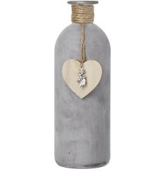 A simple yet stylish natural toned bottle featuring a woven jute neck and hanging heart decal
