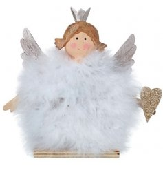 An angelic little wooden angel decoration featuring a fuzzy white feather body and glittery accents