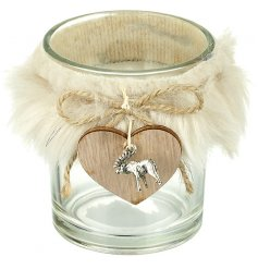 A charming glass candle holder with an added white faux fur covering and hanging wooden heart decal