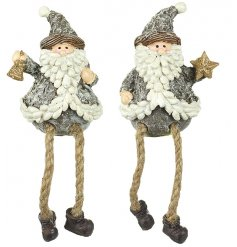 An assortment of rustic themed mini Santa figures decorated in grey tones