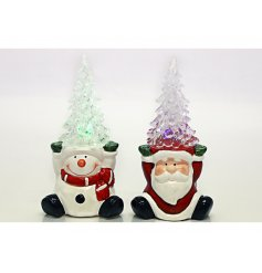Bring a colourful glow to any home space at Christmas with this festive assortment of Santa and Snowman figures