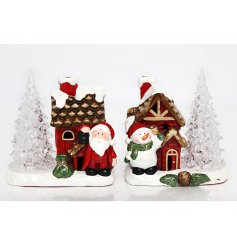 A festive assortment of ceramic house scenes complete with LED lights