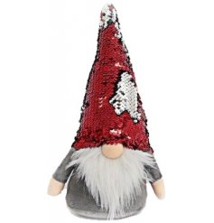 A nordic Santa with a tall sequin, colour changing hat.
