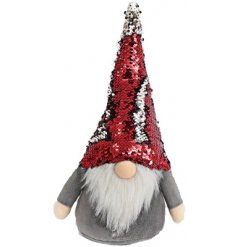 This nordic Santa has a fluffy long beard and a jazzy tall hat.