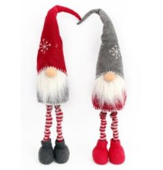 Two standing Santas with long legs and tall hats in traditional red