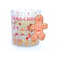 A gingerbread cookie scented gel candle within a decorative glass candle holder.