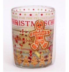 A festive ginger bread printed glass candle pot with a sweet smelling wax centre and gel like surround