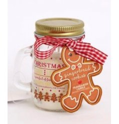 A festive ginger bread printed mason jar filled with a sweet smelling wax centre
