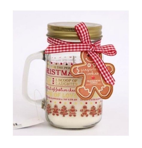 A delightful scented candle set within a traditional mason jar with gold metal lid.