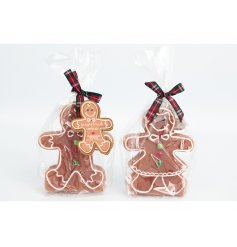 Two assorted jolly festive gingerbread candles in a gorgeous gingerbread cookie scent.