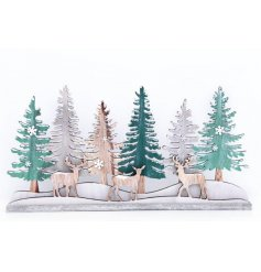 A charming 3D woodland winter scene of trees and reindeer.