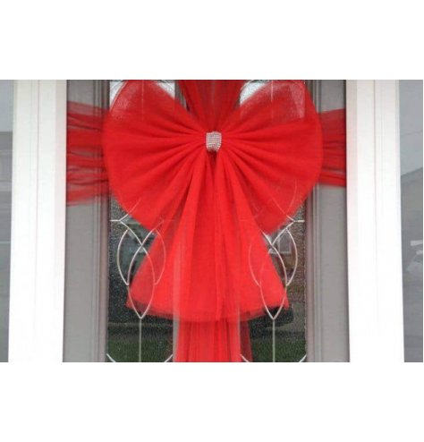 Wrap your home with love with this large red Christmas bow featuring silver diamantes.