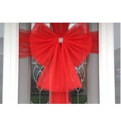 A festive red coloured bow that is suitable for front doors at Christmas