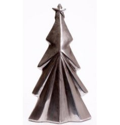 A distressed silver toned tree ornament with a Contemporary inspired theme