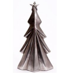 A standing tree decoration set in a rough silver tone