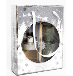 Sweetly scented mini candles and reed diffuser, beautifully packaged within a Snowflake scattered display box