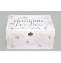 A sleek and stylish wooden Christmas Eve Box featuring a white base tone and added silver decals and prints