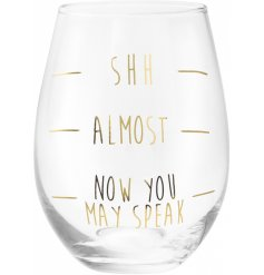 A comical scripted wine glass with added level lines