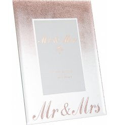 A beautifully sleek and sparkly mirrored picture frame with an added golden glitter falling effect