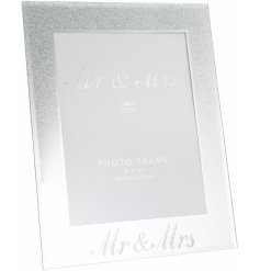 "A beautifully sleek and sparkly mirrored picture frame with an added silver glitter falling effect and scripted ""Mr & M"
